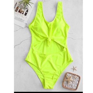 Neon green cut out one piece bathing suit